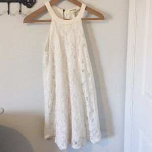 Nice white lacy dress by Monteau